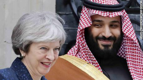 Britain's Prime Minister Theresa May (L) greets Saudi Arabia's Crown Prince Mohammed bin Salman (R) outside 10 Downing Street, in central London on March 7, 2018.