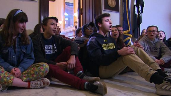 Protesters in front of Mitch McConnell's