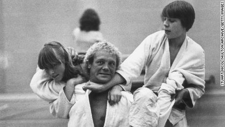 7th July 1980:  Judo champion Brian Jacks spars with Jane Dorrell and Chris French at the opening of a new sports centre in London's Shoreditch.  (Photo by Stuart Nicol/Evening Standard/Getty Images)
