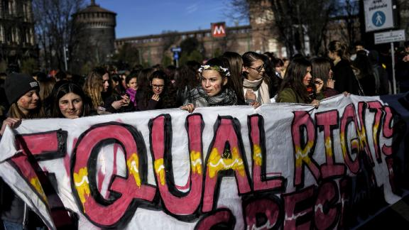 Young women take part in the Women March against Violence as part of International Women's day, on March 8, 2018 in Milan. / AFP PHOTO / MARCO BERTORELLO        (Photo credit should read MARCO BERTORELLO/AFP/Getty Images)