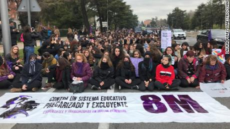Students in Madrid partially blocked a central road in the city's university district Thursday.