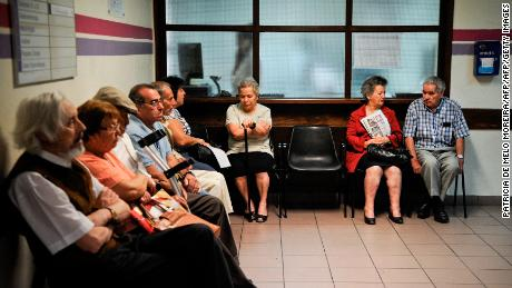 People sit in the in Sao Jose hospital waiting room during a doctors strike in Lisbon on July 11, 2012. Doctors are on strike until July 12 with, it is expected, a high adhesion in hospitals. AFP PHOTO/ PATRICIA DE MELO MOREIRA        (Photo credit should read PATRICIA DE MELO MOREIRA/AFP/GettyImages)