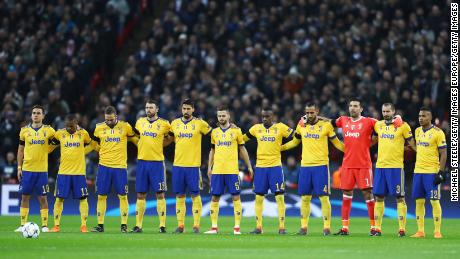Juventus players link arms during minute's silence in memory of Davide Astori.