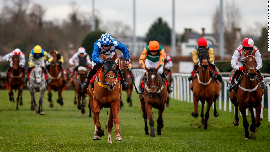 Frost (left) races clear of the field at Kempton Park racecourse in February.
