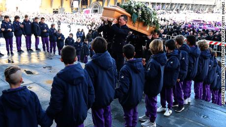 The coffin of Fiorentina captain Davide Astori is carried into the Basilica di Santa Croce ahead of the funeral service on Thursday morning
