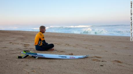 Australia's Mick Fanning waits on the beach during the World Surfing League Quicksilver Pro  during the 2015 World Surfing League Quiksilver Pro France in Hossegor, southwestern France, on October 15, 2015.
