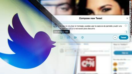 (FILES) This file photo taken on September 11, 2013 shows the logo of the social networking website 'Twitter' displayed on a computer screen in London. 