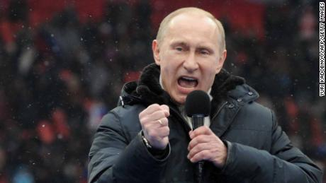 "Russian Presidential candidate, Prime Minister Vladimir Putin delivers a speech during a rally of his supporters at the Luzhniki stadium in Moscow on February 23, 2012. Prime Minister Vladimir Putin on Thursday vowed he would not allow foreign powers to interfere in Russia's internal affairs and predicted victory in an ongoing battle for its future. ""We will not allow anyone interfere in our internal affairs,"" Putin said in a speech to more than 100,000 people packed into the stadium and its grounds at Moscow's Luzhniki stadium ahead of March 4 presidential elections.