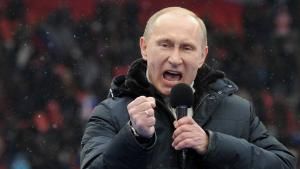 "Russian Presidential candidate, Prime Minister Vladimir Putin delivers a speech during a rally of his supporters at the Luzhniki stadium in Moscow on February 23, 2012. Prime Minister Vladimir Putin on Thursday vowed he would not allow foreign powers to interfere in Russia's internal affairs and predicted victory in an ongoing battle for its future. ""We will not allow anyone interfere in our internal affairs,"" Putin said in a speech to more than 100,000 people packed into the stadium and its grounds at Moscow's Luzhniki stadium ahead of March 4 presidential elections. . AFP PHOTO/AFP PHOTO / YURI KADOBNOV (Photo credit should read YURI KADOBNOV/AFP/Getty Images)"