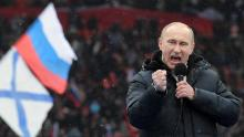 """Russian Presidential candidate, Prime Minister Vladimir Putin delivers a speech during a rally of his supporters at the Luzhniki stadium in Moscow on February 23, 2012. Prime Minister Vladimir Putin on Thursday vowed he would not allow foreign powers to interfere in Russia's internal affairs and predicted victory in an ongoing battle for its future. """"We will not allow anyone interfere in our internal affairs,"""" Putin said in a speech to more than 100,000 people packed into the stadium and its grounds at Moscow's Luzhniki stadium ahead of March 4 presidential elections. . AFP PHOTO/AFP PHOTO / YURI KADOBNOV        (Photo credit should read YURI KADOBNOV/AFP/Getty Images)"""