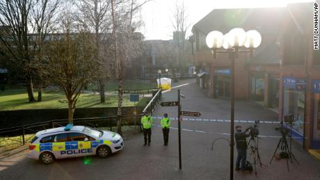 "Police officers guard a cordon around a police tent covering the the spot where former Russian double agent Sergei Skripal and his daughter were found critically ill Sunday following exposure to an ""unknown substance"" in Salisbury, England, Wednesday, March 7, 2018. Britain's counterterrorism police took over an investigation Tuesday into the mysterious collapse of the former spy and his daughter, now fighting for their lives. The government pledged a ""robust"" response if suspicions of Russian state involvement are proven. Sergei Skripal and his daughter are in a critical condition after collapsing in the English city of Salisbury on Sunday. (AP Photo/Matt Dunham)"