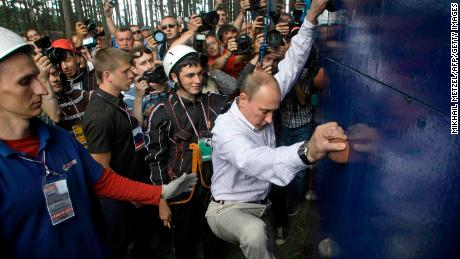 Putin scales a climbing wall at a summer camp run by the political Nashi youth group at Lake Seliger in northern Russia.