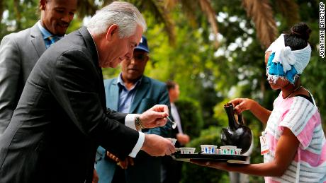 U.S. Secretary of State Rex Tillerson receives a cup of brewed coffee during a traditional coffee ceremony at the U.S. embassy in Addis Ababa, Ethiopia, Thursday, March 8, 2018.