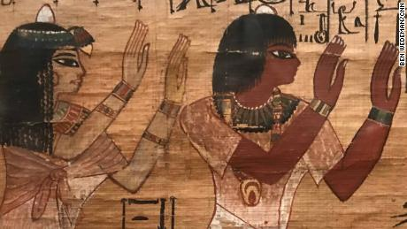 Merit, a woman who lived around 3400 years ago during Egypt's New Kingdom period. She died at the age of 25 from causes unknown. The boxes that contained her toiletries and other possessions are painted with images of a confident woman side by side with her architect husband, Kha, giving offerings to the gods.