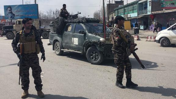 Afghan security forces keep watch near the site of an explosion in Kabul on March 9.