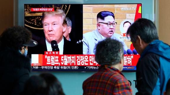 "People watch a TV screen showing North Korean leader Kim Jong Un and U.S. President Donald Trump, left, at the Seoul Railway Station in Seoul, South Korea, Friday, March 9, 2018. Trump has accepted an offer of a summit from the North Korean leader and will meet with Kim Jong Un by May, a top South Korean official said Thursday, in a remarkable turnaround in relations between two historic adversaries. The signs read: "" Trump has accepted an offer of a summit from the North Korean leader and will meet with Kim by May."" (AP Photo/Ahn Young-joon)"