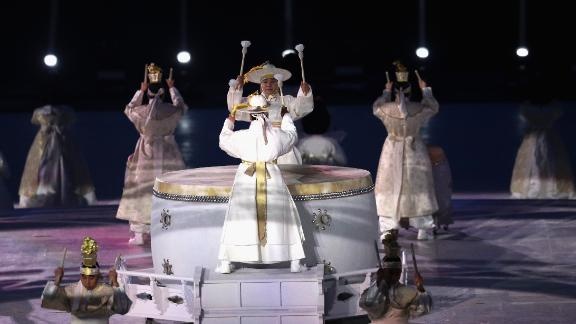 Drummers perform on the traditional Korean buk drums at the opening ceremony.