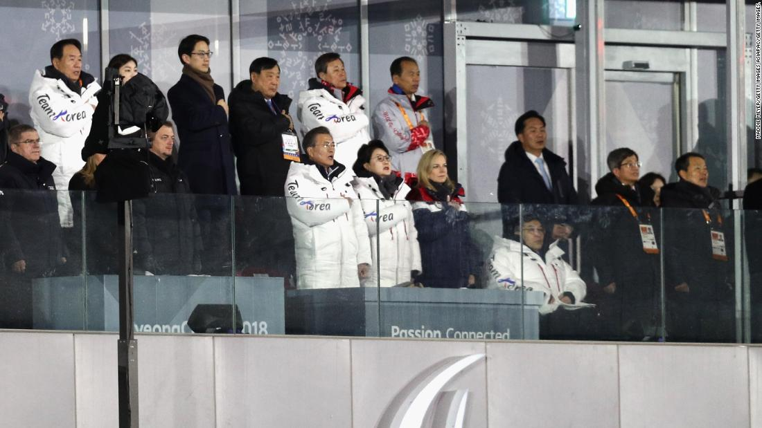 South Korean President Moon Jae-in -- front row, middle -- sings the national anthem at the opening ceremony on Friday.