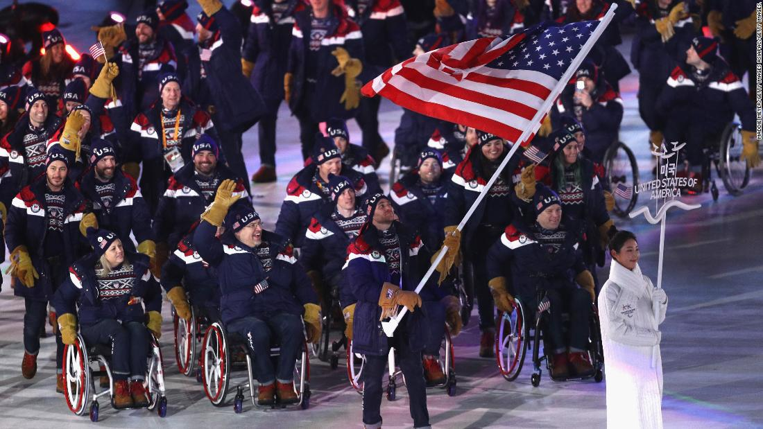 Team USA enter the arena in the Parade of Nations led by para snowboarder Mike Schultz.