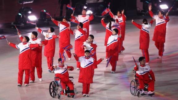 The North Korean delegation follow their two athletes into the arena during the Parade of Nations.