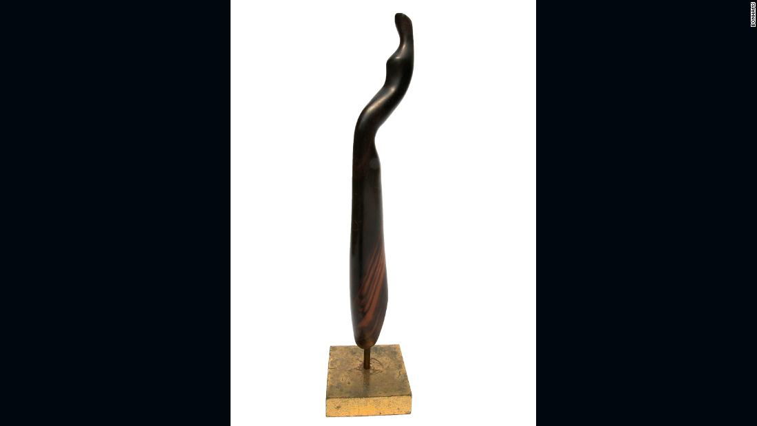 Standing female figure 30 x 4 x 3cm (11 13/16 x 1 9/16 x 1 3/16in).