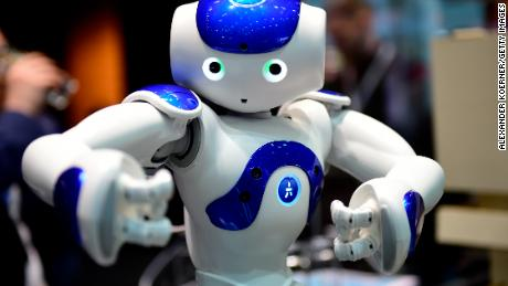"HANOVER, GERMANY - MARCH 20: The robot ""Nao"" performs Tai Chi at the IBM stand at the CeBIT 2017 Technology Trade Fair on March 20, 2017 in Hanover, Germany. ""Nao"" has a face detection and can either play football, teach Tai Chi or just entertain. The 2017 CeBIT will run from March 20-24. (Photo by Alexander Koerner/Getty Images)"