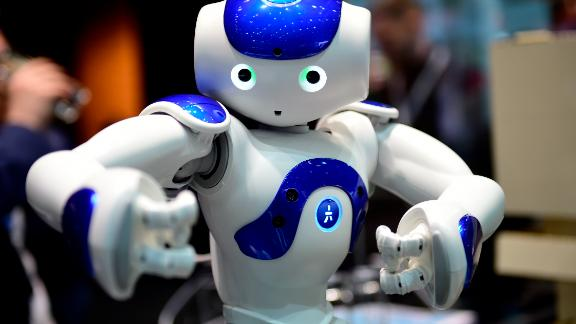 """HANOVER, GERMANY - MARCH 20: The robot """"Nao"""" performs Tai Chi at the IBM stand at the CeBIT 2017 Technology Trade Fair on March 20, 2017 in Hanover, Germany. """"Nao"""" has a face detection and can either play football, teach Tai Chi or just entertain. The 2017 CeBIT will run from March 20-24. (Photo by Alexander Koerner/Getty Images)"""