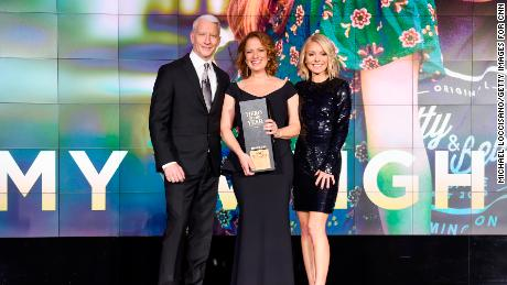 NEW YORK, NY - DECEMBER 17:  (L-R) Anderson Cooper, 2017 CNN Hero of the year Amy Wright, and Kelly Ripa pose onstage during CNN Heroes 2017 at the American Museum of Natural History on December 17, 2017 in New York City. 27437_017  (Photo by Michael Loccisano/Getty Images for CNN)