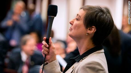 Florida Rep. Elizabeth Porter (R-Lake City) raises her microphone to ask a question during the school safety bill on the House floor at the Florida Capital in Tallahassee, Fla., Tuesday March 6, 2018. (AP Photo/Mark Wallheiser)