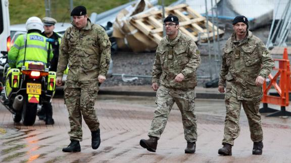 Military personnel, pictured arriving at Salisbury District Hospital on Friday, were deployed to help remove potentially contaminated vehicles and help gather evidence.