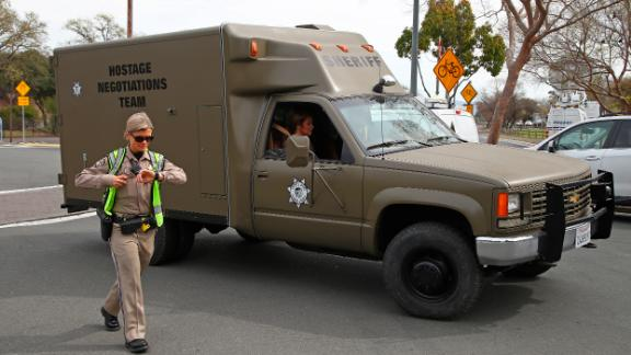 A sheriff's hostage negotiation team passes a California Highway Patrol checkpoint at the Veterans Home of California in Yountville.
