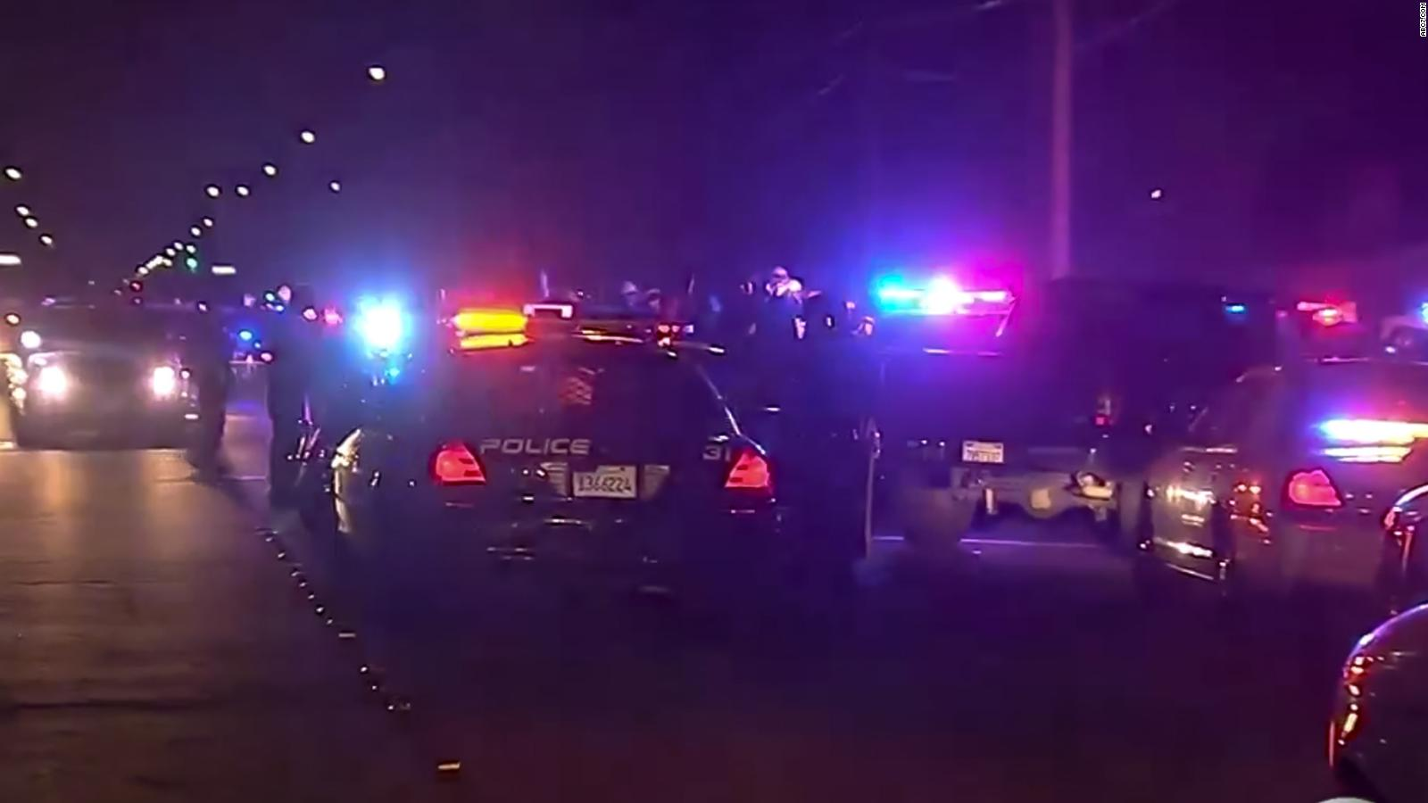 California officer dead as standoff continues