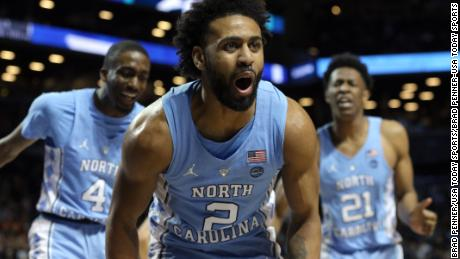 North Carolina Tar Heels guard Joel Berry II (2) reacts with North Carolina Tar Heels guard Brandon Robinson (4) and North Carolina Tar Heels forward Sterling Manley (21) during the semifinal game of the 2018 ACC tournament against the Duke Blue Devils at Barclays Center.
