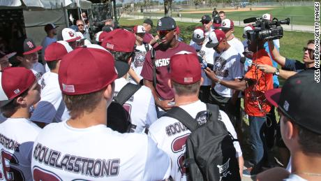 Lewis Brinson of the Miami Marlins talks to the Marjory Stoneman Douglas baseball team prior to the spring training game against the St. Louis Cardinals on February 23, 2018.