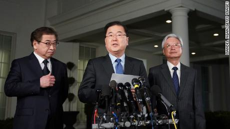 South Korean National Security Advisor Chung Eui-yong (C), flanked by South Korea National Intelligence Service chief Suh Hoon (L) and South Korea's ambassador to the United States Cho Yoon-je (2nd-R), briefs reporters outside the West Wing of the White House on March 8, 2018 in Washington, DC, announcing North Korean leader Kim Jong Un has offered to meet US President Donald Trump. / AFP PHOTO / MANDEL NGAN        (Photo credit should read MANDEL NGAN/AFP/Getty Images)