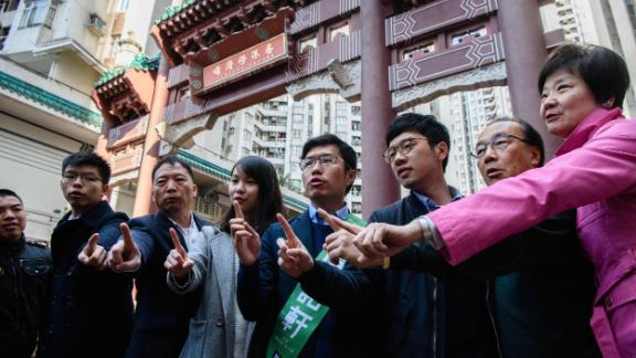 Pro-democracy campaigners Joshua Wong, left, Agnes Chow, third from left, and Nathan Law campaign for by-election candidate Au Nok-hin, center, for the Legislative Council by-elections in Hong Kong on March 11, 2018.