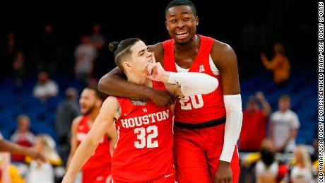 Houston Cougars guard Rob Gray (32) gives a hush signal to the Wichita State Shockers crowd along with teammate Gabe Grant (20) as they celebrate their upset win in the AAC Basketball Tournament at Amway Center.