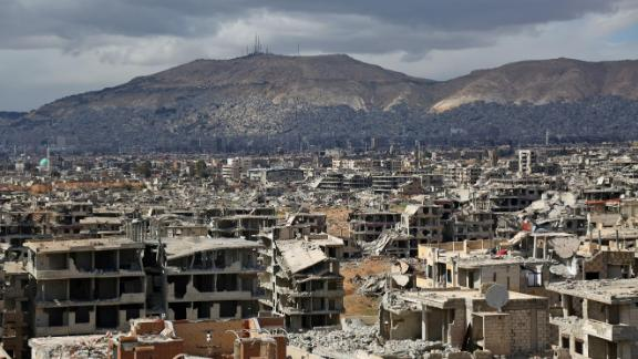 TOPSHOT - A picture taken on February 27, 2018 shows a view of the rebel-held neihgbourhood of Jobar, on the eastern edge of the Syrian capital Damascus following a reported regime bombardment, with Mount Qasioun seen in the background. / AFP PHOTO / Ammar SULEIMAN        (Photo credit should read AMMAR SULEIMAN/AFP/Getty Images)