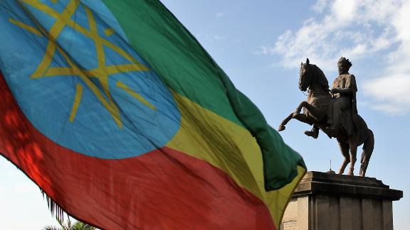 A statue of King II Menelik statue and the Ethiopian Flag in Addis Ababa on March 2, 2017. (Photo by Mohammed Abdu Abdulbaqi/Anadolu Agency/Getty Images)