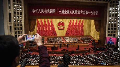 "BEIJING, CHINA - MARCH 11: China's President Xi Jinping, (bottom C), joins a session of the National People's Congress to vote on a constitutional amendment at The Great Hall Of The People on March 11, 2018 in Beijing, China. In an historic vote, Chinese lawmakers abolished presidential term limits and paved the way for Xi Jinping to rule indefinitely. Only two delegates out of 2,964 voted against the controversial change and three abstained at the annual gathering of Communist Party loyalists seen as a rubber-stamp exercise. Amending the constitution to allow the 64-year old Xi the possibility of being a ""leader for life"" has stirred worries of China's return to an era of autocratic rule not seen since Mao Zedong. When the Communist Party announced the proposal to scrap term limits in February it said the move was needed to maintain stability and continuity as China navigates its economic and political rise. (Photo by Kevin Frayer/Getty Images)"