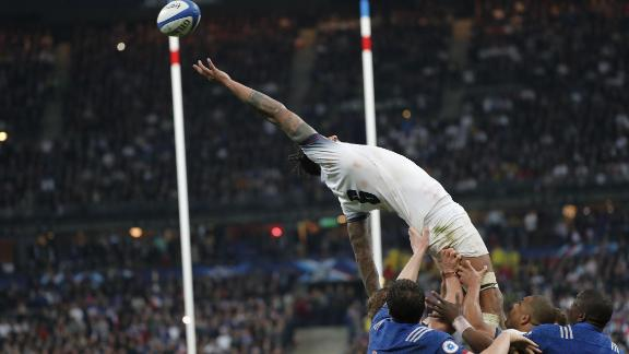 England lock Courtney Lawes loses grip of a line out at the Stade de France.