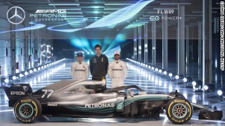 TOPSHOT - Mercedes AMG Petronas Formula One drivers Finland's Valtteri Bottas (L) and Britain's Lewis Hamilton (R), with Mercedes AMG Petronas Formula One Team Principal and Executive Director, Toto Wolff ,(C), pose alongside the new 2018 season Mercedes-AMG F1 W09 EQ Power+ Formula One car during its launch at Silverstone motor racing circuit near Towcester, central England on February 22, 2018.  / AFP PHOTO / Justin TALLIS        (Photo credit should read JUSTIN TALLIS/AFP/Getty Images)