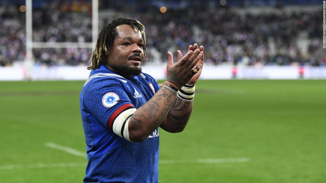 Center Mathieu Bastareaud salutes the crowd. France has won both its games since his return to the side.