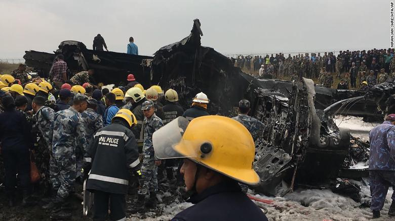 Rescuers survey the wreckage of the plane.
