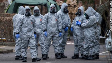 Military personnel wearing protective suits investigate the poisoning of Sergei Skripal in Salisbury, England.