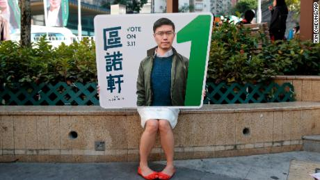 A supporter holds a poster of Hong Kong pro-democracy by-election winner Au Nok-hin.