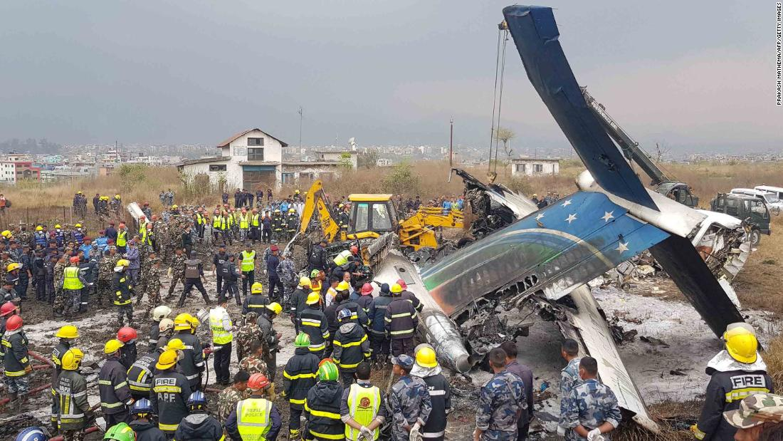 "Emergency personnel work around the wreckage of a plane that crashed while landing at the Tribhuvan Airport in Kathmandu, Nepal, on Monday, March 12. Flight BS 211, which was flying in from Dhaka, Bangladesh, <a href=""https://www.cnn.com/2018/03/12/asia/kathmandu-plane-crash/index.html"" target=""_blank"">crashed and burst into flames</a> after approaching the runway from the wrong direction, officials said. Dozens were killed."