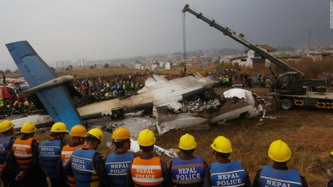 Rescuers gather around the crash site on March 12.