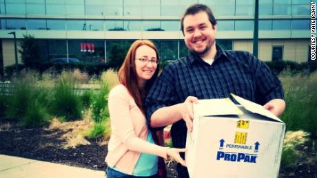 Kate and Jeremy Plant with a box of medications needed for in-vitro fertilization.