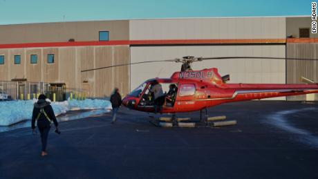 The N350LH helicopter shown here with no doors later crashed into the East River on Sunday.